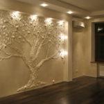 фото барельефа в виде дерева на стене
