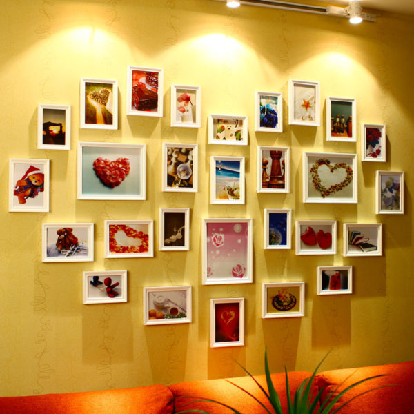 оригинальное исполнение стены фотографиями